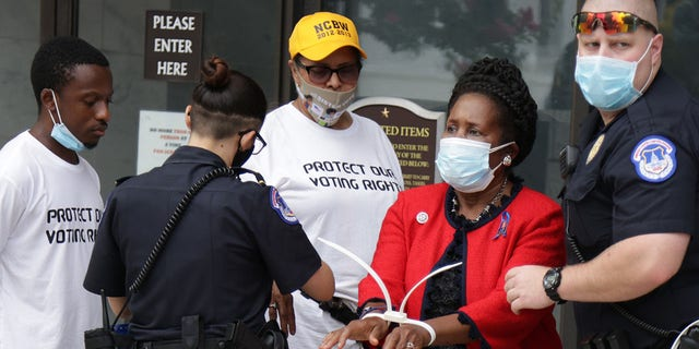 U.S. Rep. Sheila Jackson Lee, D-Texas, is arrested by a member of U.S. Capitol Police as she participates in a civil disobedience during a protest outside Hart Senate Office Building on Capitol Hill, July 29, 2021. (Getty Images)
