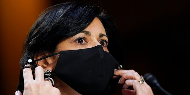 Dr. Rochelle Walensky, director of the Centers for Disease Control and Prevention, adjusts her face mask during a Senate Health, Education, Labor and Pensions Committee hearing on Thursday, March 18, 2021. The CDC this week announced new recommendations that Americans should wear masks even if vaccinated in many areas. (AP Photo/Susan Walsh, Pool, File)