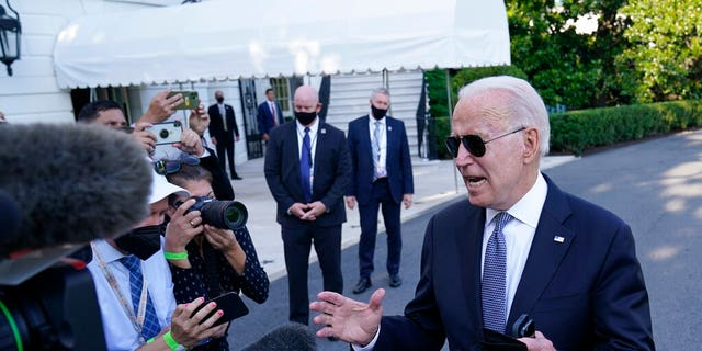 President Joe Biden talks with reporters before boarding Marine One on the South Lawn of the White House in Washington, Friday, July 30, 2021, as he heads Camp David for the weekend. (Associated Press)