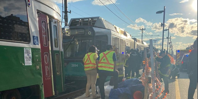 A collision between two Boston trains Friday evening left at least 25 people with non-life-threatening injuries, authorities said.