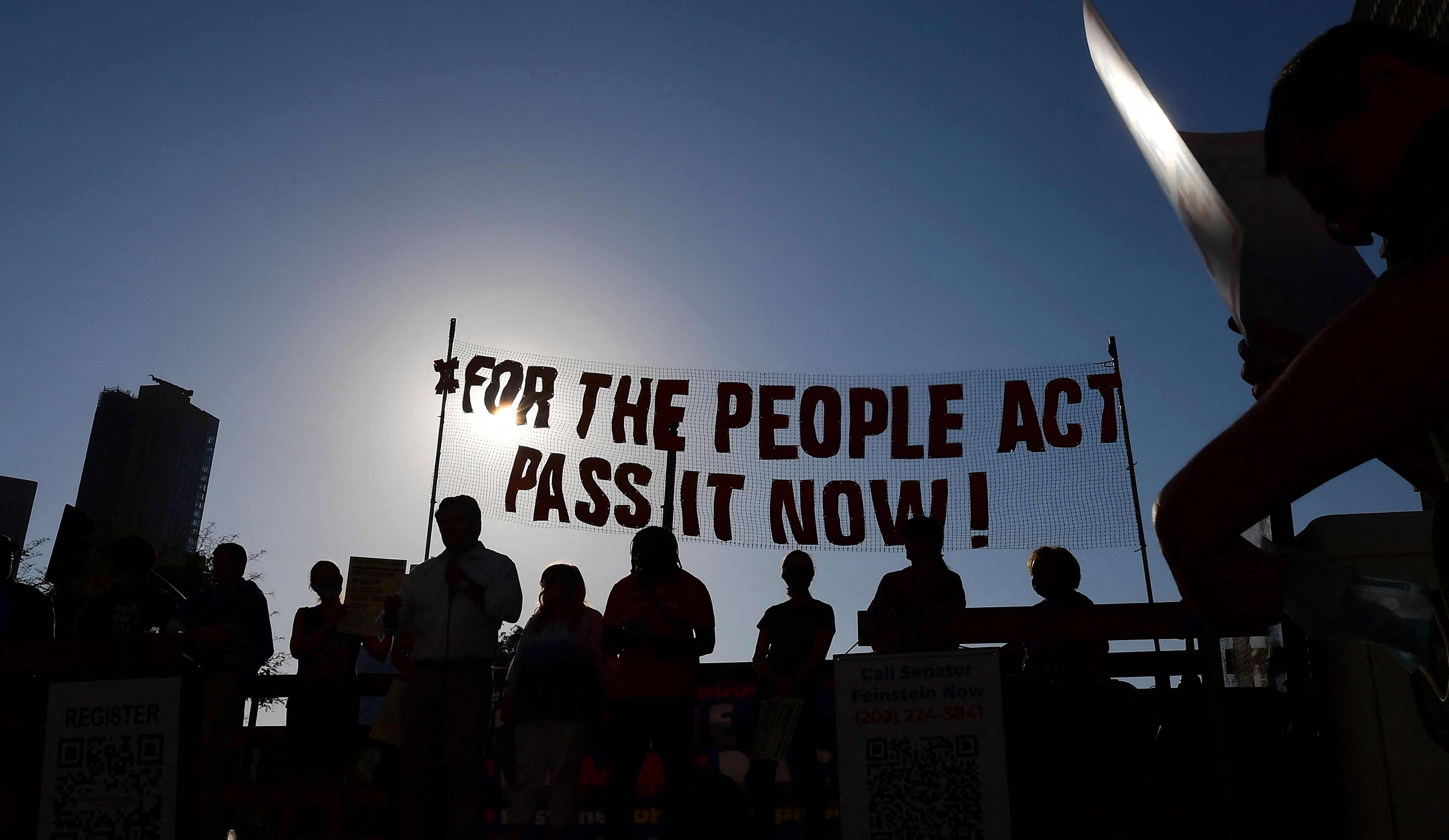 Activists from various grassroots organizations rally outside City Hall in Los Angeles on July 7 to call on Congress and Sen.