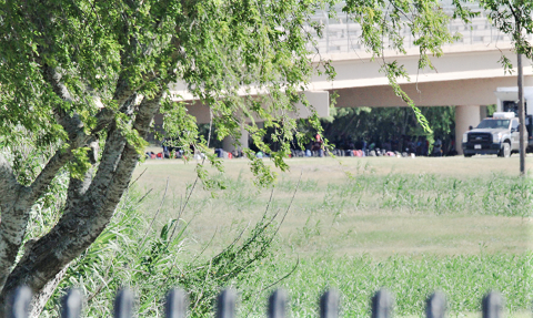 Officials line up hundreds of migrants' backpacks near the temporary outdoor detention area set up by Del Rio Sector officials due to overcrowding. (Photo: Randy Clark/Breitbart Texas)