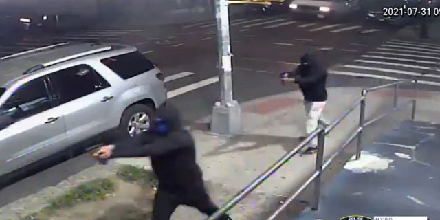 Two hooded and masked suspects opened fire on a crowd of people Saturday night.