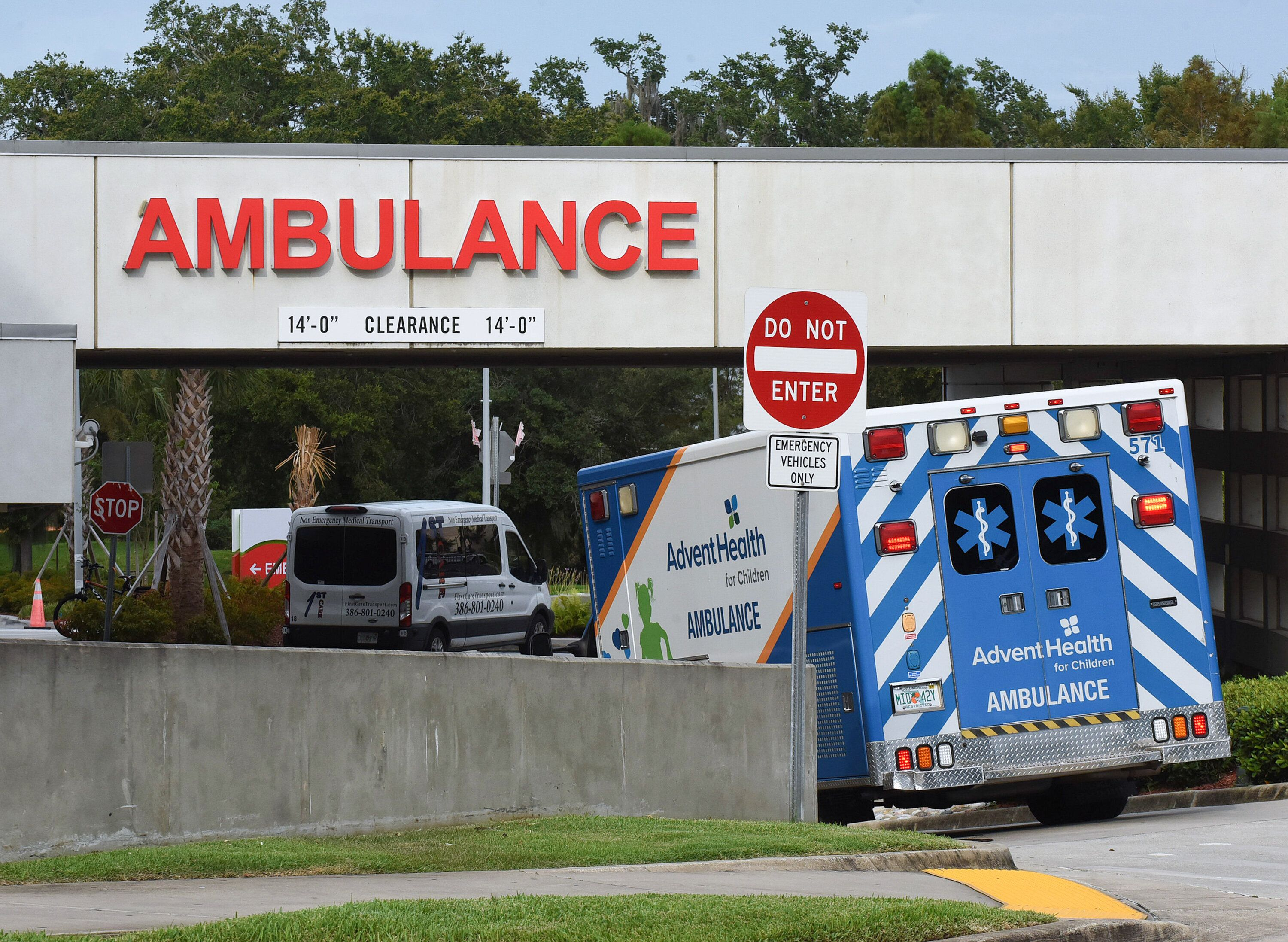 An ambulance arrives at the emergency department at AdventHealth hospital in Orlando on July 26, the day that hospital offici