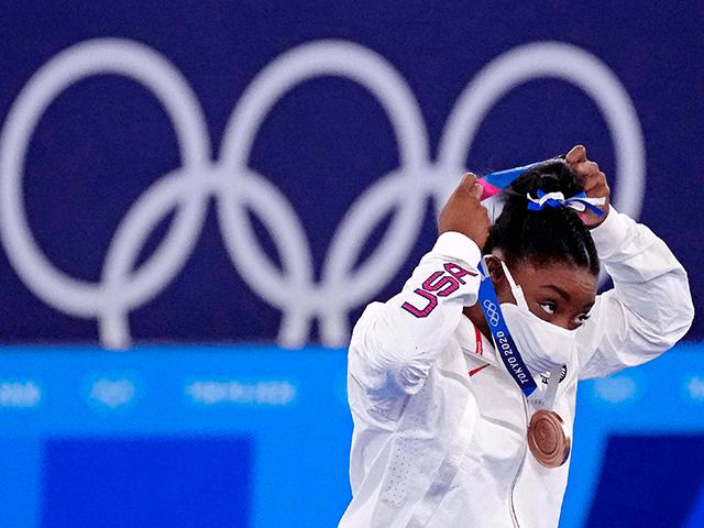 Aug 3, 2021; Tokyo, Japan; Simone Biles (USA) celebrates winning the bronze medal on the balance beam during the Tokyo 2020 Olympic Summer Games at Ariake Gymnastics Centre. Mandatory Credit: Robert Deutsch-USA TODAY Sports