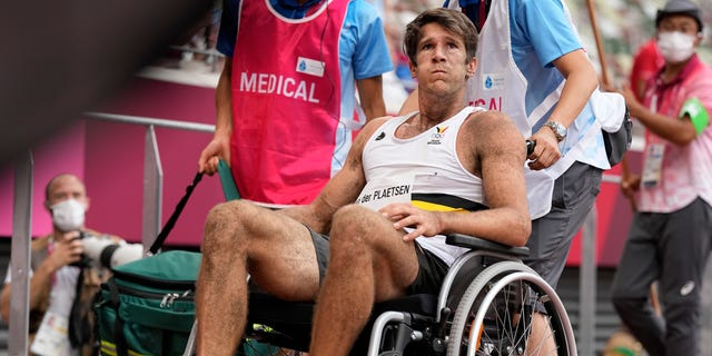 Thomas Van Der Plaetsen, of Belgium is taken from the field following a fall in the long jump of the decathlon at the 2020 Summer Olympics, Wednesday, Aug. 4, 2021, in Tokyo. (AP Photo/David J. Phillip)