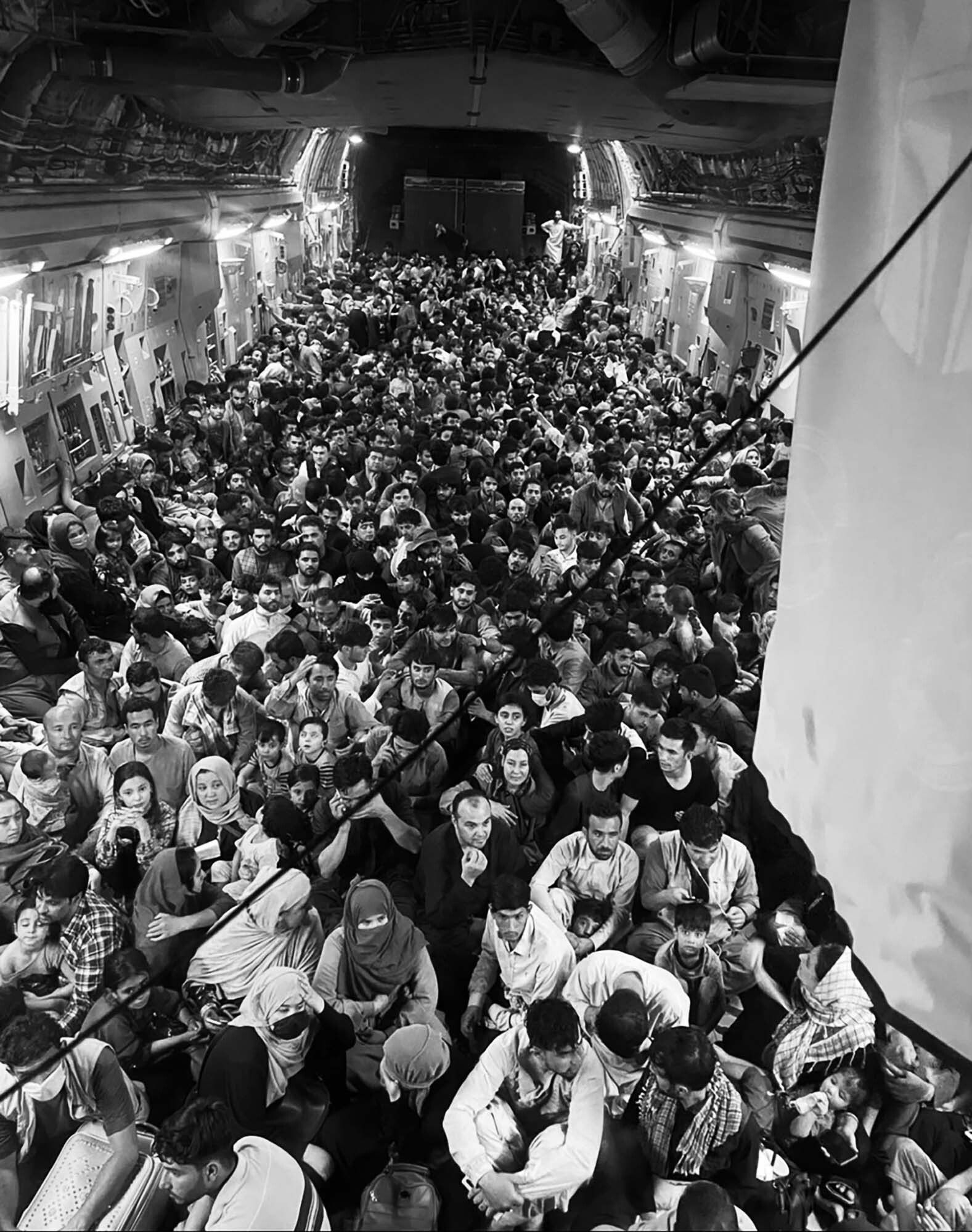 Afghan citizens are packed inside a U.S. Air Force C-17 Globemaster III as they're transported from Hamid Karzai Internationa