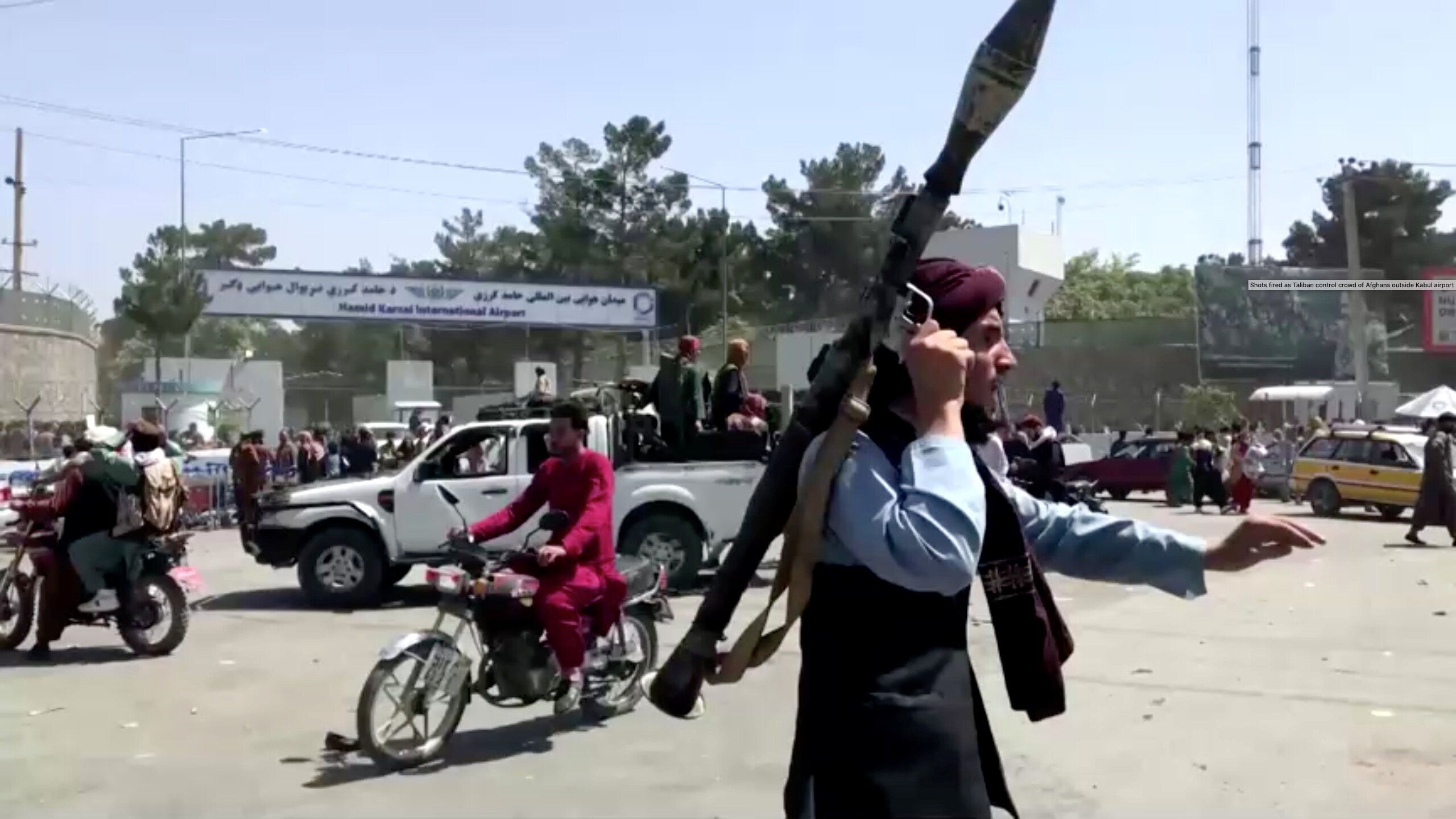 A Taliban fighter doing crowd-control outside Kabul airport.