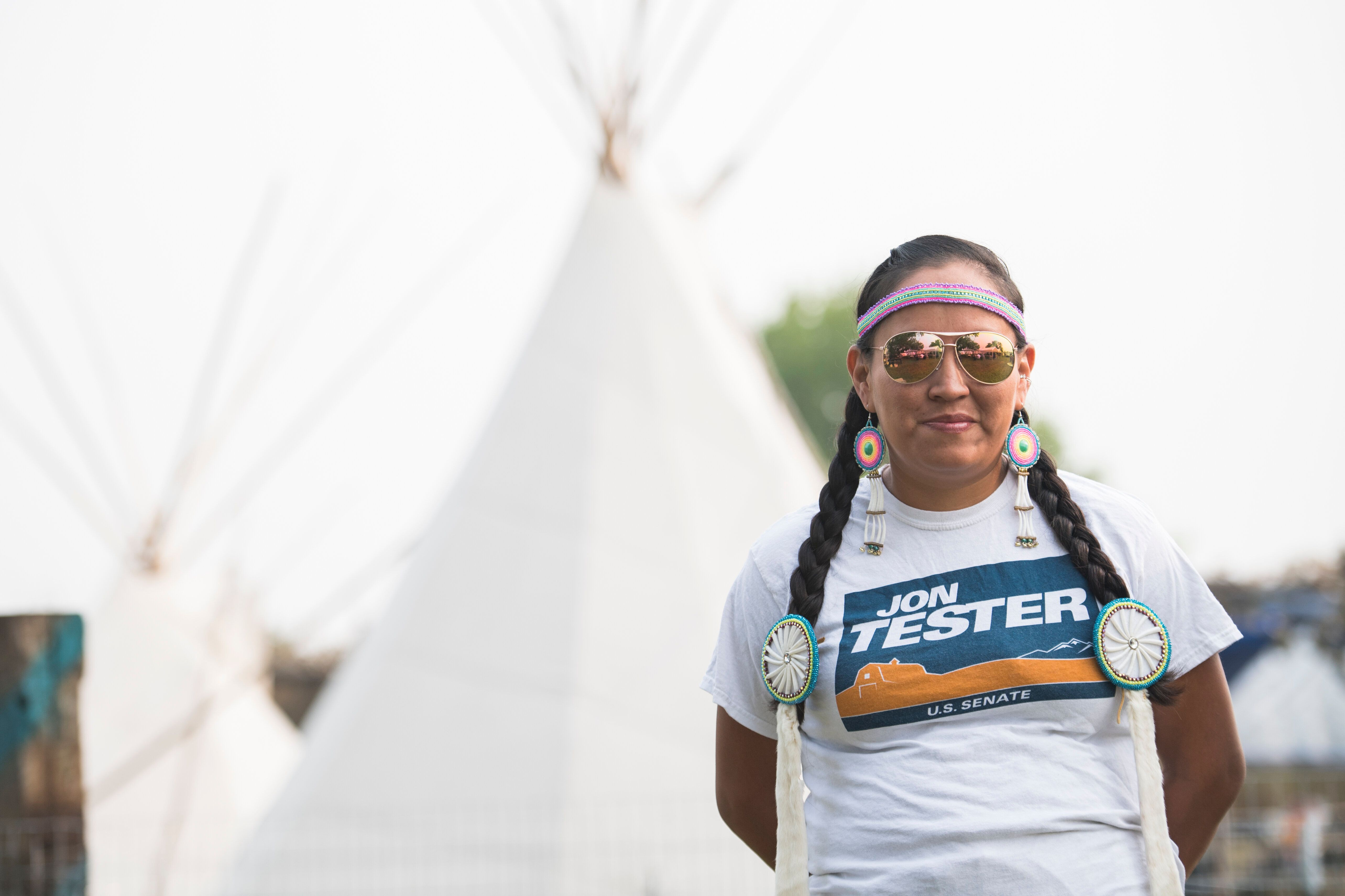 A campaign worker for Sen. Jon Tester (D-Mont.), a co-sponsor of the Native American Rights Act, attends the Crow Fair in Cro