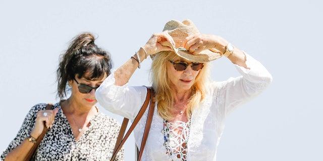 Former Bond girl Susie Vanner arrives at Club 55 In Saint-Tropez.