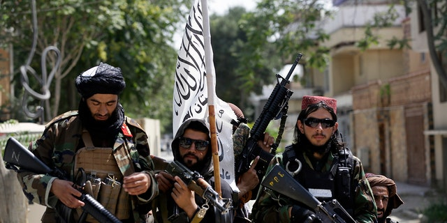 Taliban fighters display their flag on patrol in Kabul, Afghanistan, Thursday, Aug. 19, 2021. (Associated Press)