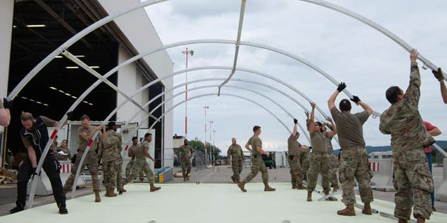 U.S. military personnel and volunteers make preparations for arriving evacuees at Ramstein Air Base in Germany. (Ramstein Air Base photo)
