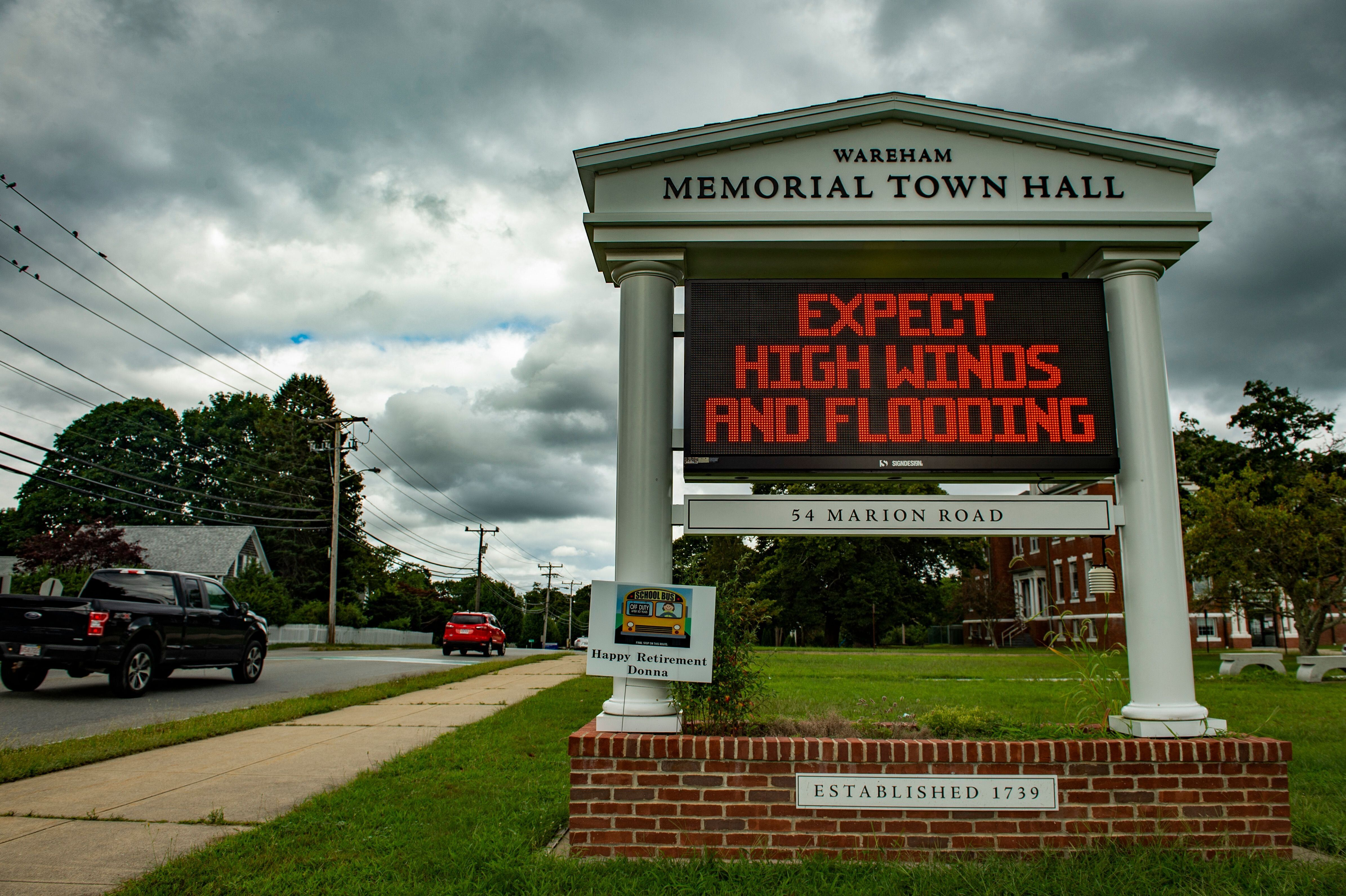 A sign outside the local Town Hall warns people to prepare for high winds and flooding as the impeding Tropical storm Henri e
