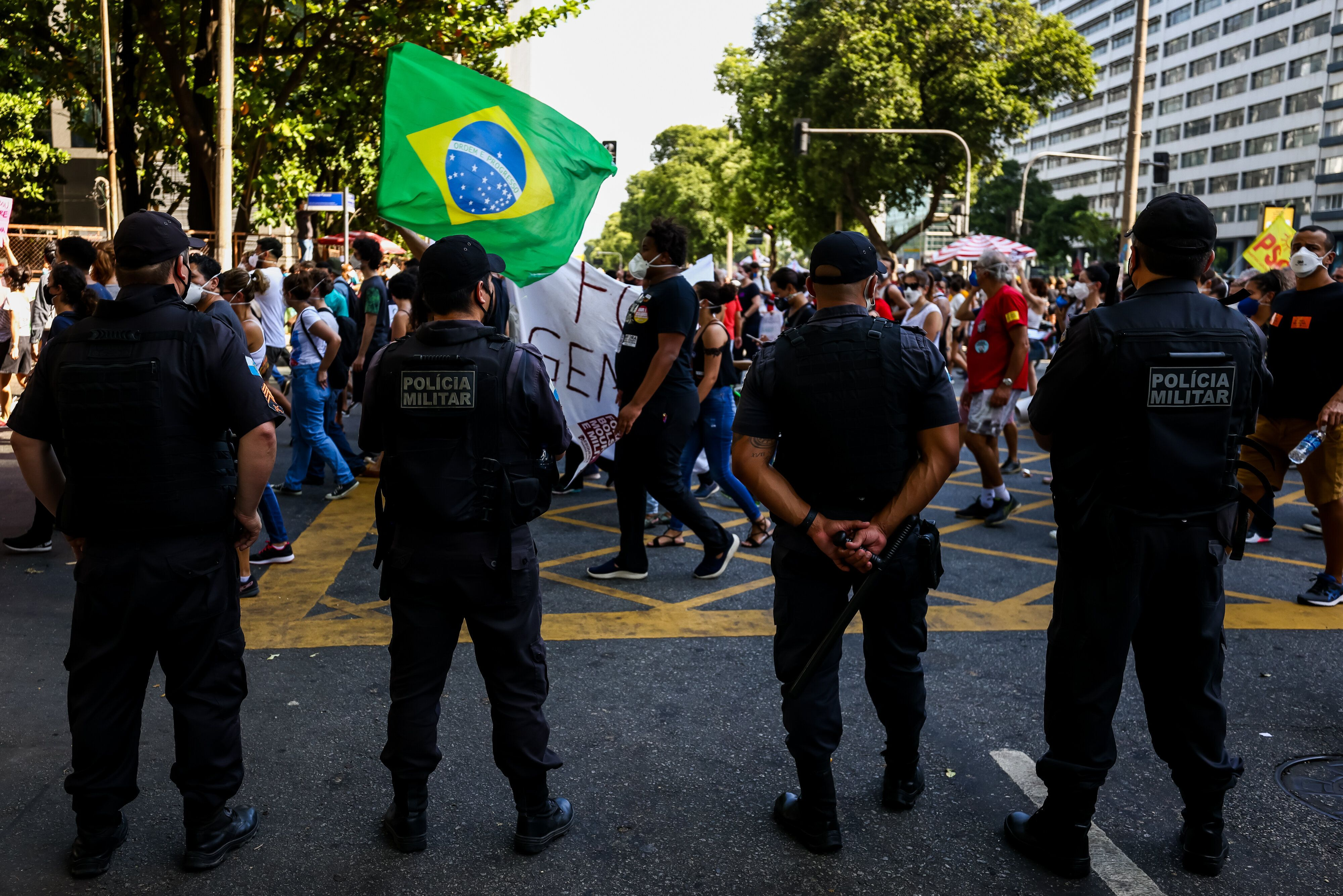 Rio de Janeiro police officers monitor a demonstration against Bolsonaro's handling of the COVID-19 pandemic. Brazil's police