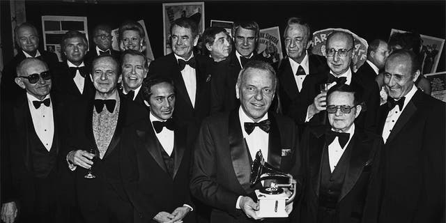 Singer Frank Sinatra (front center) holds a Grammy Awards as he is honored by celebrity friends Paul Anka, Glenn Ford, Phil Harris, Rich Little, Red Skelton, Julie Styne, Dean Martin, Dina Merrill and Henry Mancini during a 1979 banquet at Cesear's Palace in Las Vegas, Nev.