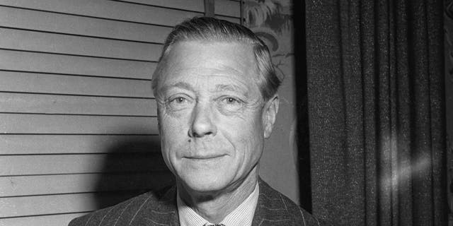 """The Duke of Windsor (1894-1972), formerly King Edward VIII, with his memoirs, entitled """"A King's Story: The Memoirs of the Duke of Windsor,"""" circa 1951."""