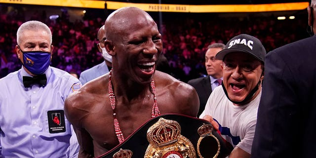 Yordenis Ugas, of Cuba, celebrates his unanimous decision win over Manny Pacquiao, of the Philippines, in a welterweight championship boxing match Saturday, Aug. 21, 2021, in Las Vegas. (AP Photo/John Locher)