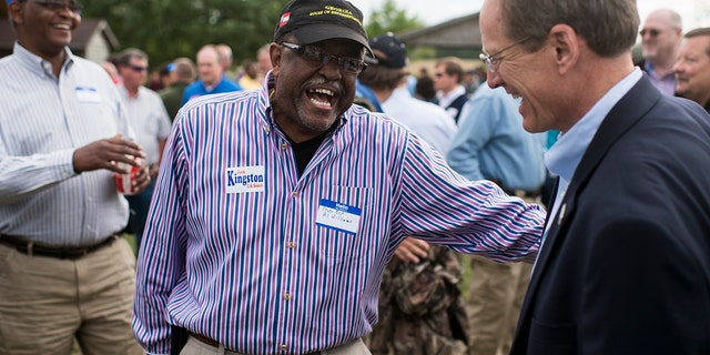 Former Candidate for U.S. Senate Rep. Jack Kingston, R-Ga., right, speaks with Georgia State Representative Al Williams at the Law Enforcement Cookout at Wayne Dasher's pond house in Glennville, Ga., on Thursday, April 17, 2014. (Photo By Bill Clark/CQ Roll Call)