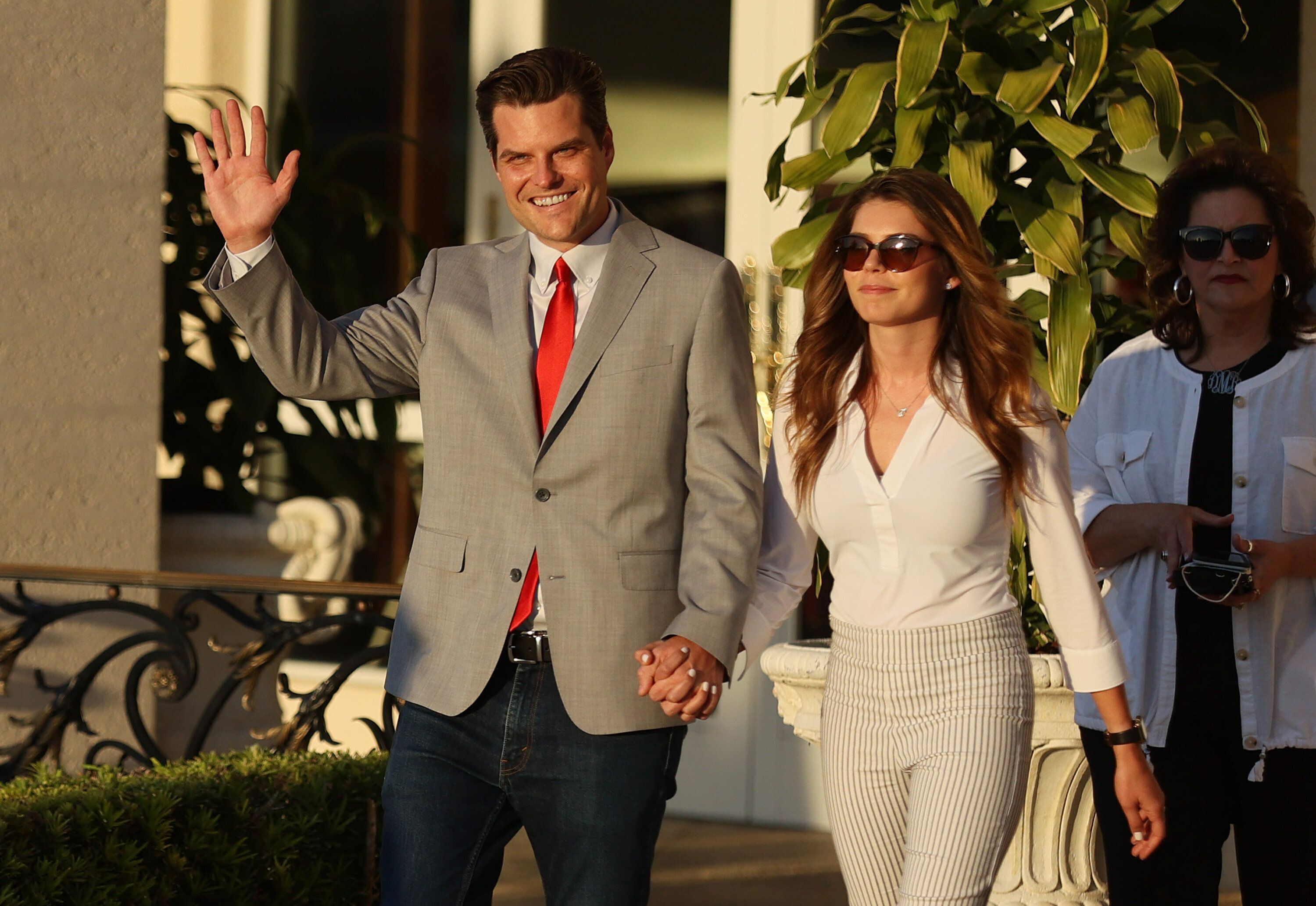 Rep. Matt Gaetz is seen with his then-girlfriend, Ginger Luckey, at the Trump National Doral golf resort in Doral, Florida on