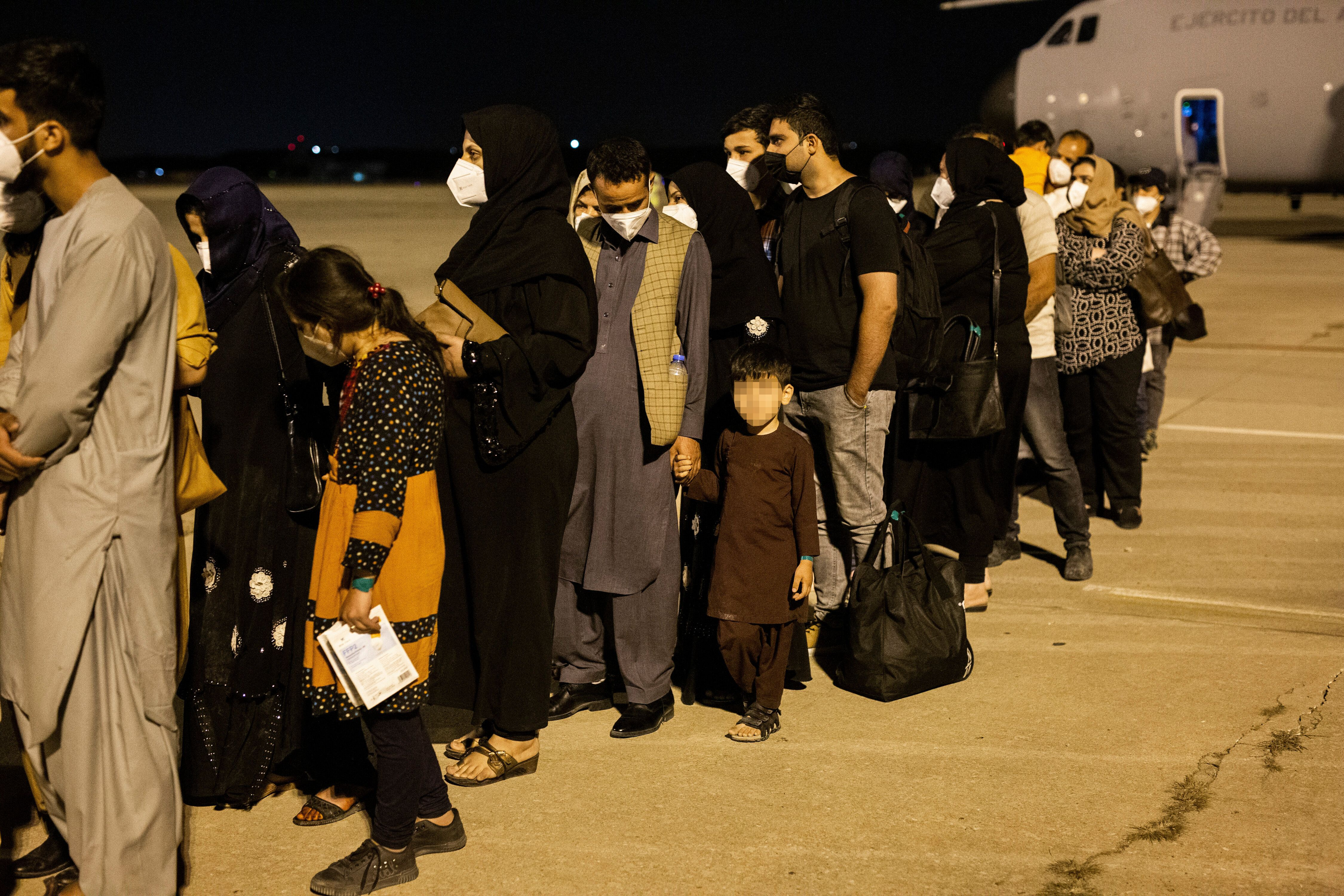 Passengers disembark a plane in Spain after evacuating from Kabul on Aug. 19. The plane, sent by the government of Spain, rep