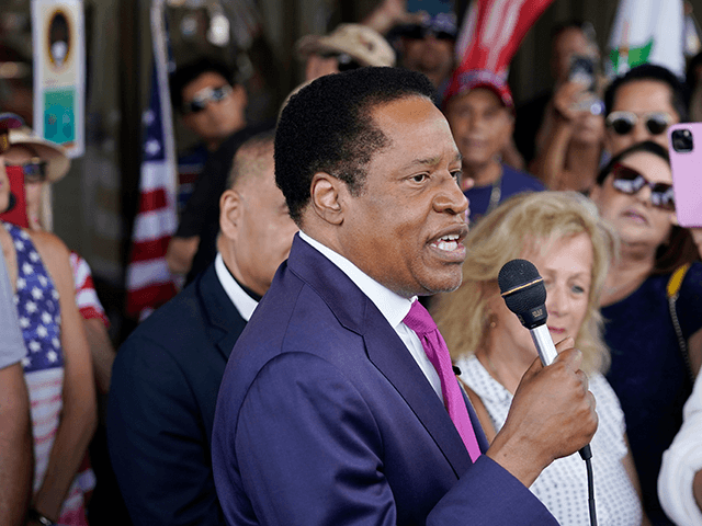 In this July 13, 2021, file photo, conservative radio talk show host Larry Elder speaks to supporters during a campaign stop in Norwalk, Calif. Elder was not on the list of candidates released Saturday in the recall election that could end the term of California Gov. Gavin Newsom. (AP Photo/Marcio Jose Sanchez, File)