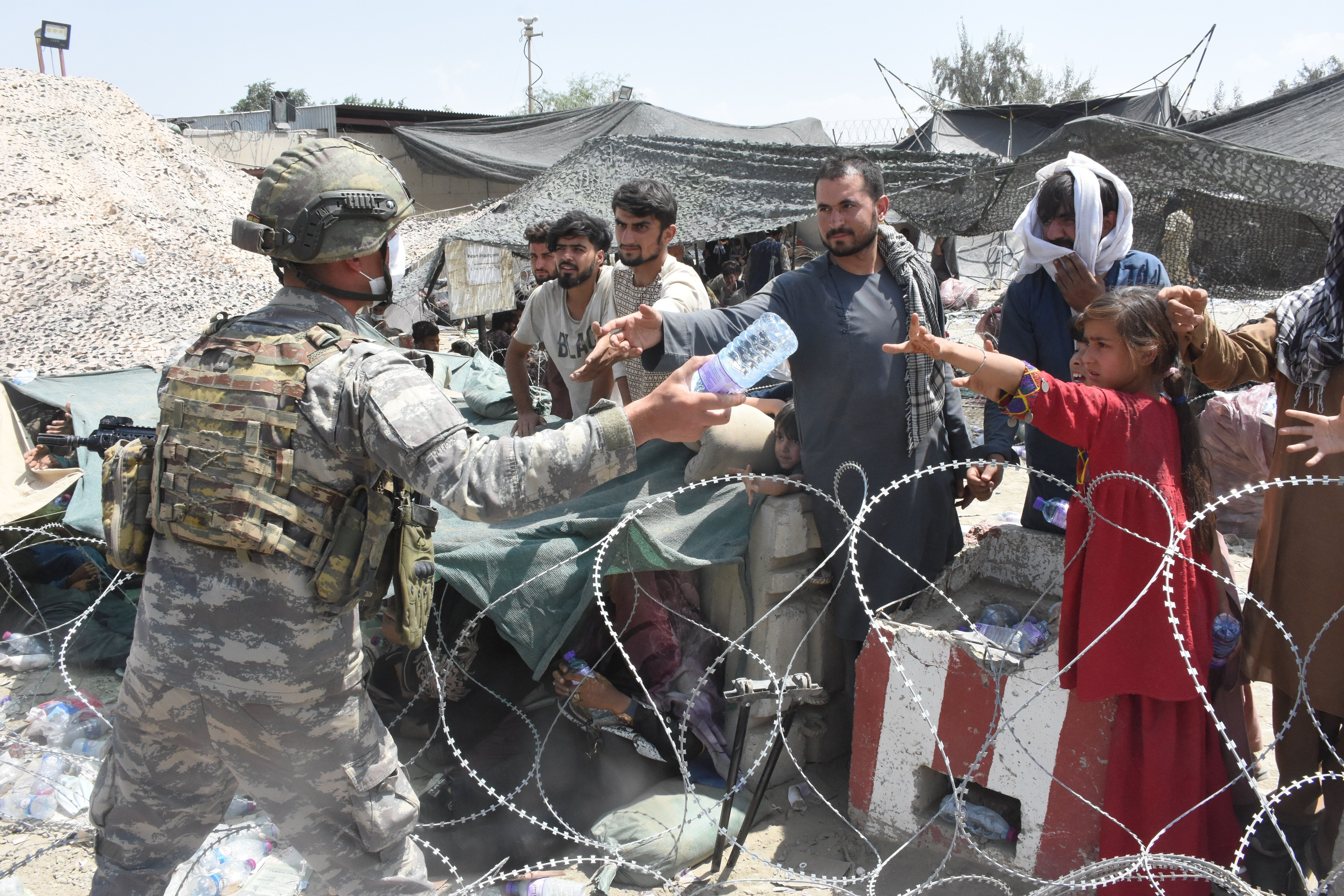 Soldiers of the Turkish Task Force in Afghanistan are on duty in and around Hamid Karzai International Airport to help people