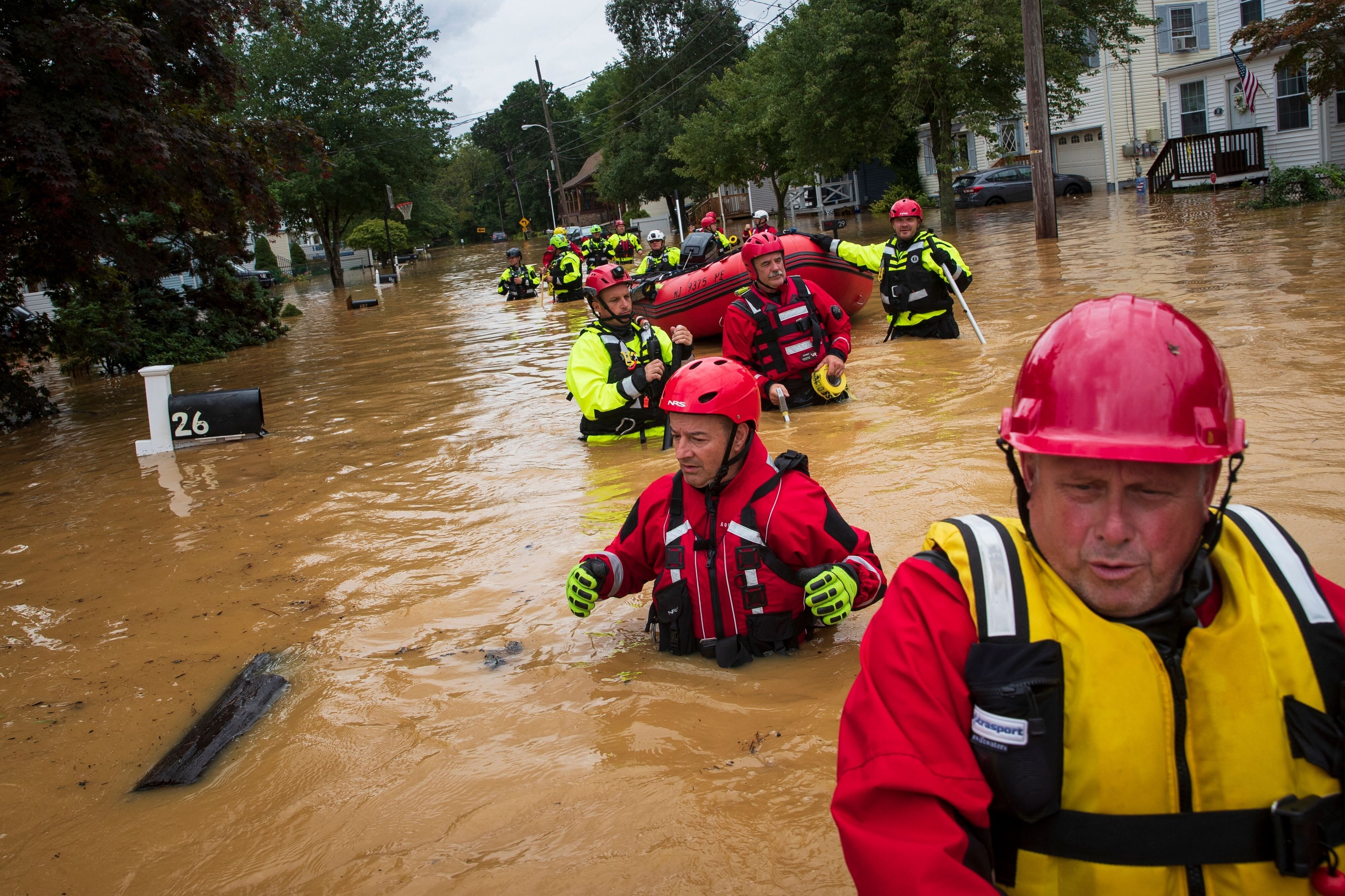 Members of the New Market Volunteer Fire Company perform a secondary search during an evacuation effort following a flash flo