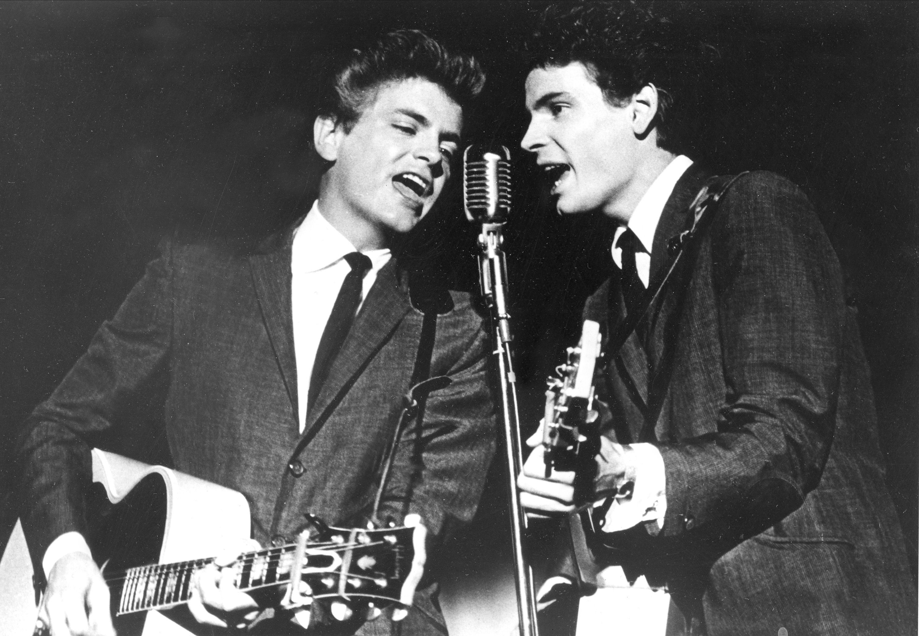 In this July 31, 1964 file photo, the Everly Brothers, Phil, left, and Don, perform on stage. (AP Photo, File)