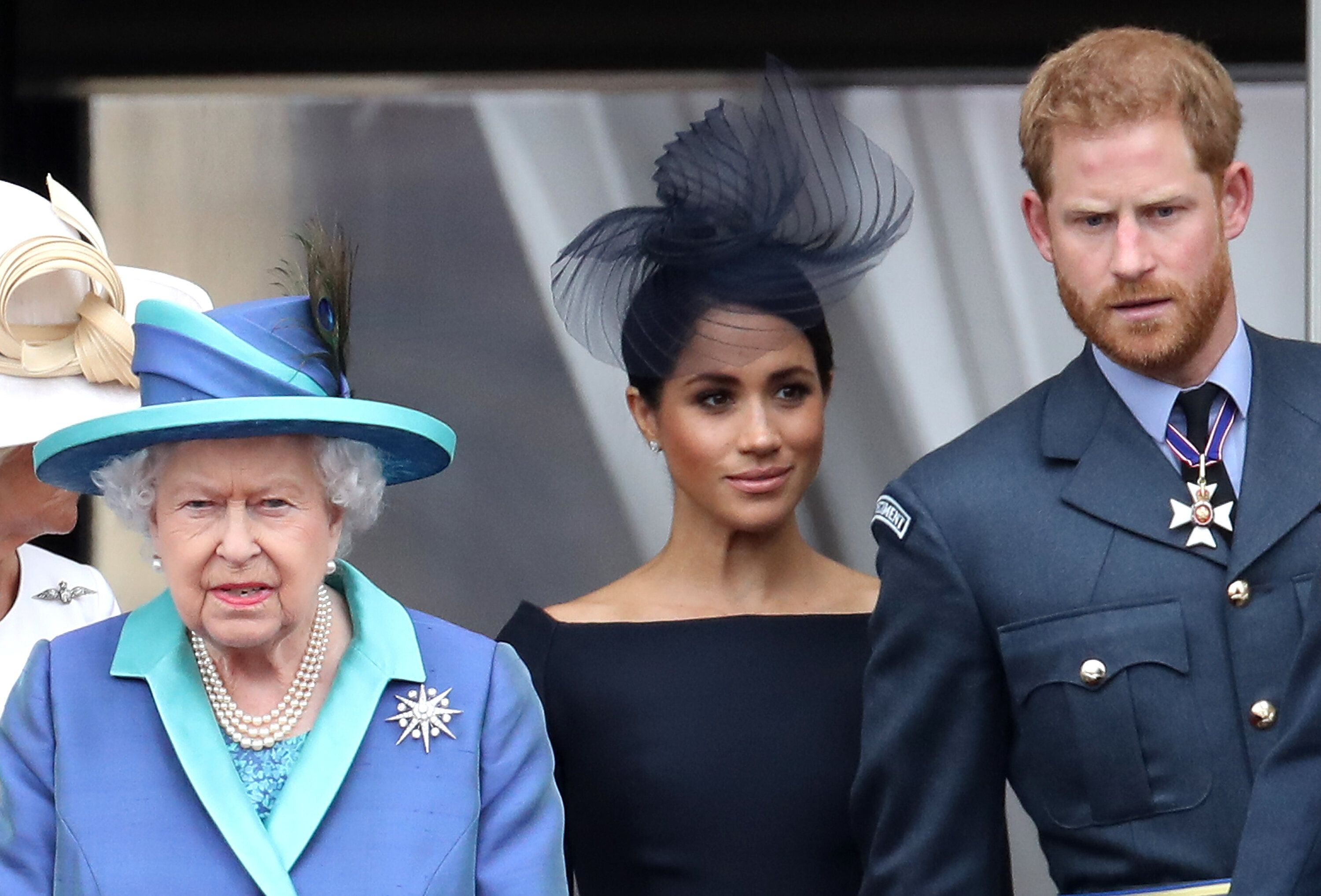 Queen Elizabeth and the Duke and Duchess of Sussex stand on the balcony of Buckingham Palace on July 10, 2018.