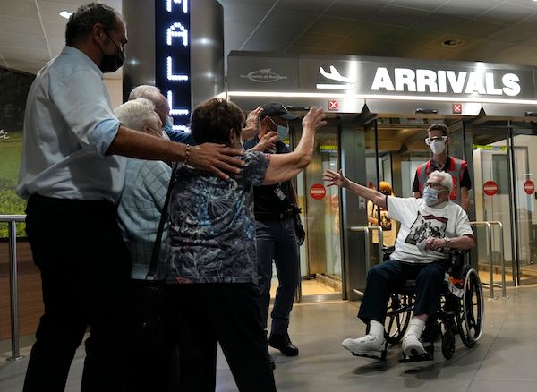 Martin Adler, a 97-year-old retired American soldier, right, reunited with the three children he saved during World War II. T