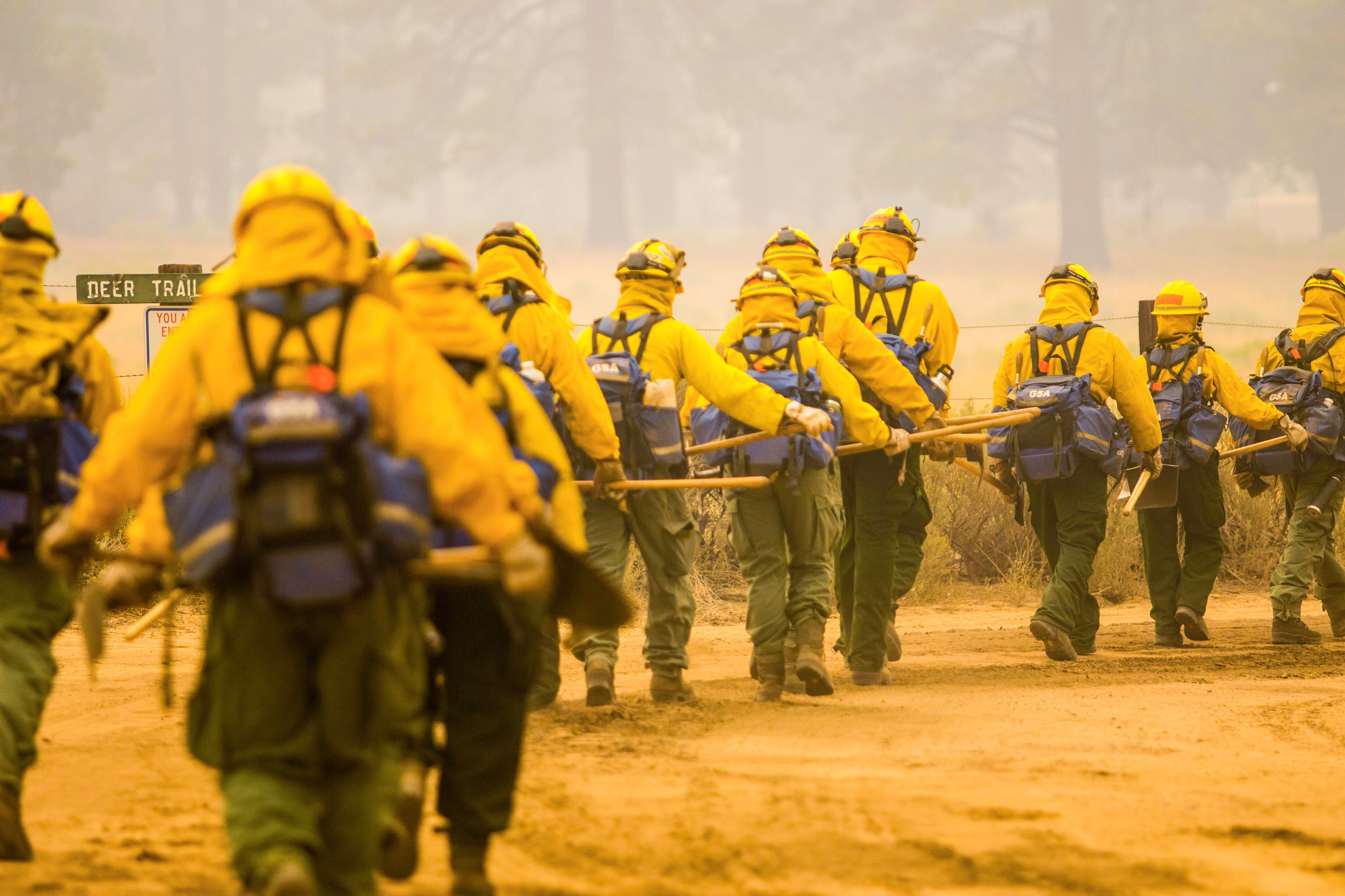 More than 13,500 firefighters were working Monday to contain a dozen large California wildfires.