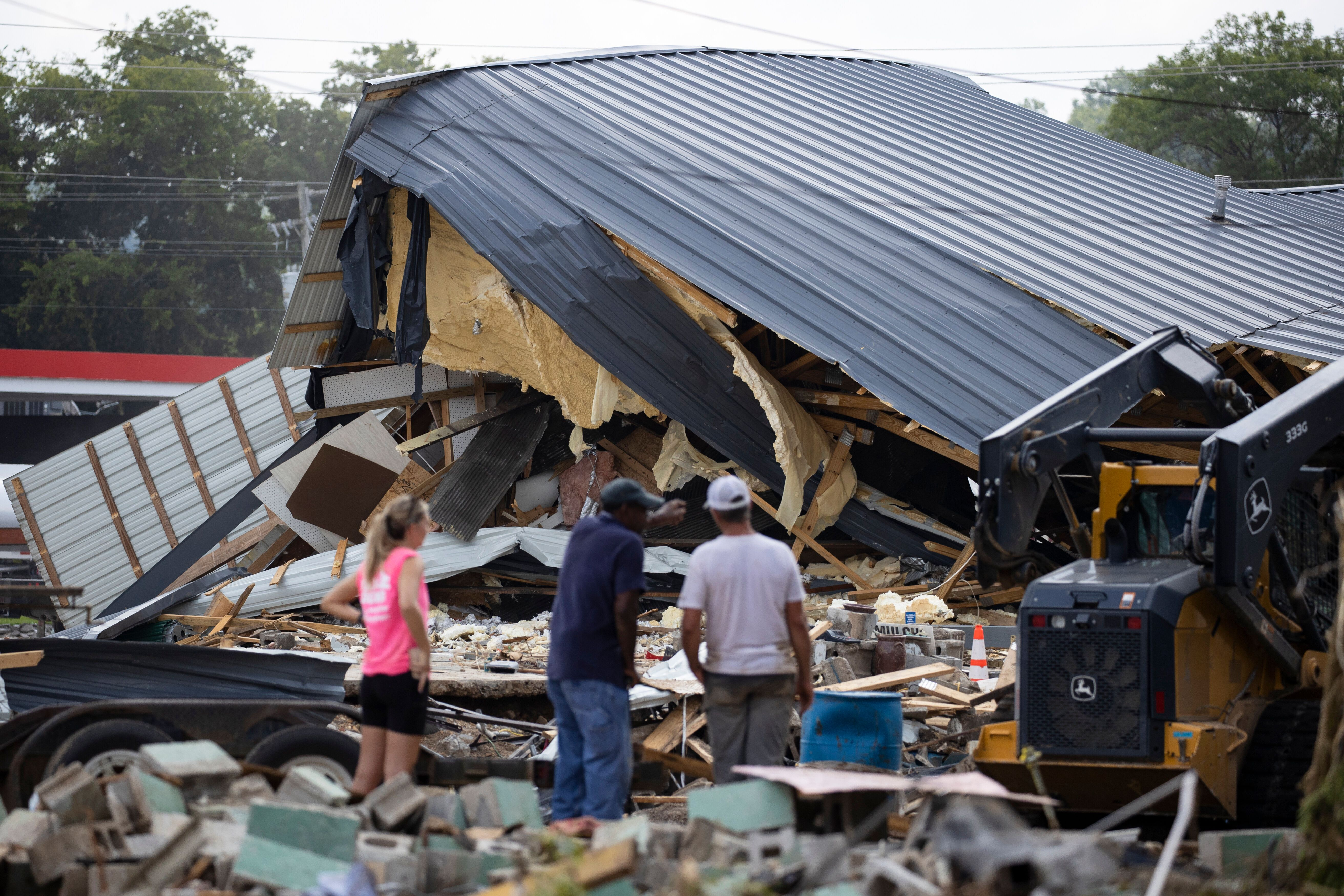 Heavy rains on Sunday caused flash flooding in central Tennessee, leaving at least 22 people dead and more than two dozen mis