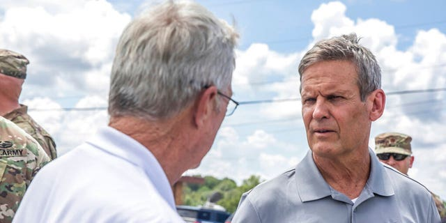 Gov. Bill Lee, right, greets officials upon arriving in Waverly, Tenn., Sunday, Aug. 22, 2021, to inspect flood damage in the area. (Alan Poizner/The Tennessean via AP, Pool)