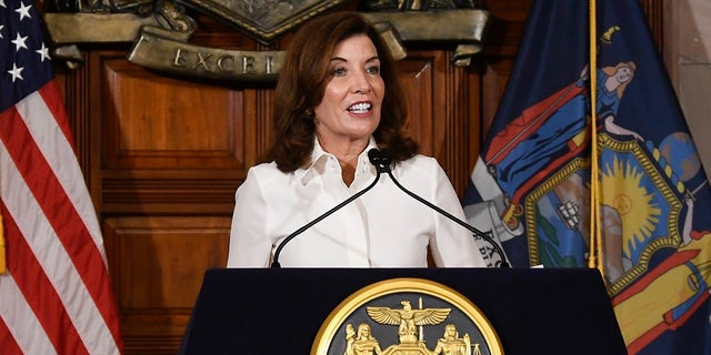 Newly sworn-in New York Gov. Kathy Hochul called for statewide mask mandates in schools and tougher COVID-19 vaccine requirements Tuesday, her first day on the job following the resignation of Gov. Andrew Cuomo amid sexual harassment allegations. (AP Photo/Hans Pennink)