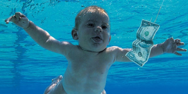 The man who was photographed as a baby on the cover of Nirvana's 'Nevermind' album is now accusing the band of child pornography.