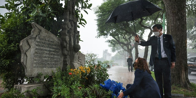 U.S. Vice President Kamala Harris lays flowers at the Senator John McCain memorial site, where his Navy aircraft was shot down by the North Vietnamese, on the three-year anniversary of his death, in Hanoi, Vietnam, Wednesday, Aug. 25, 2021. (Associated Press)