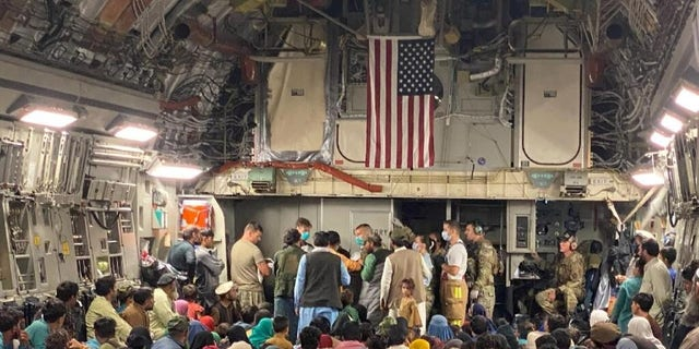 A 315th Airlift Wing aircrew from Joint Base Charleston, South Carolina helped to deliver a baby aboard a C-17 Globemaster III carrying vulnerable Afghans evacuated from Afghanistan, Aug. 23, moments before landing at a Middle East staging area. (U.S. Air Force courtesy photo)