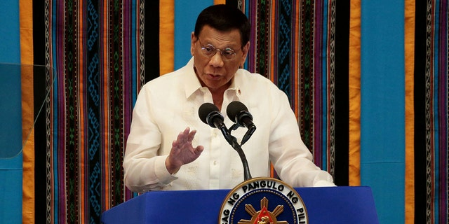 Philippine President Rodrigo Duterte gestures during his fourth State of the Nation Address at the Philippine Congress in Quezon City, Philippines in 2019.