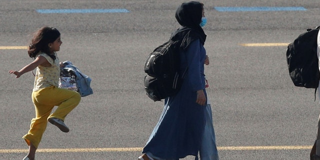 A moving photo of a young Afghan girl skipping on the tarmac of a Belgian airport after being evacuated from her war-torn native country has gone viral.