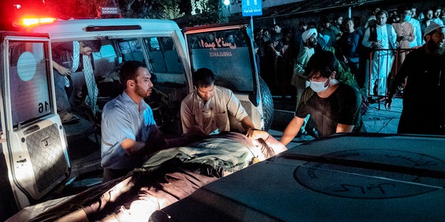 Victims of Thursday's attack at the Kabul airport in Afghanistan arrive at the Emergency Surgical Center for War Victims. (Reuters)