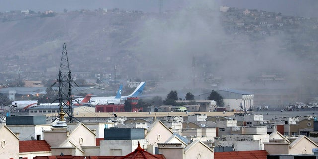 Smoke rises from a deadly explosion outside the airport in Kabul, Afghanistan, Thursday, Aug. 26, 2021. (Associated Press)