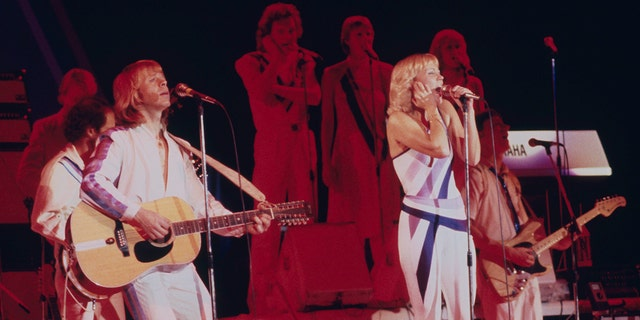 Singers Agnetha Fältskog (right) and Björn Ulvaeus performing with Swedish pop group Abba on their third, and final, tour, 1979.
