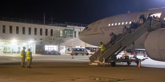 The first flight carrying evacuated personnel of British Embassy staff and various British nationals arrives from Kabul at RAF Brize Norton in England on Aug. 16. (AP/Ministry of Defence)