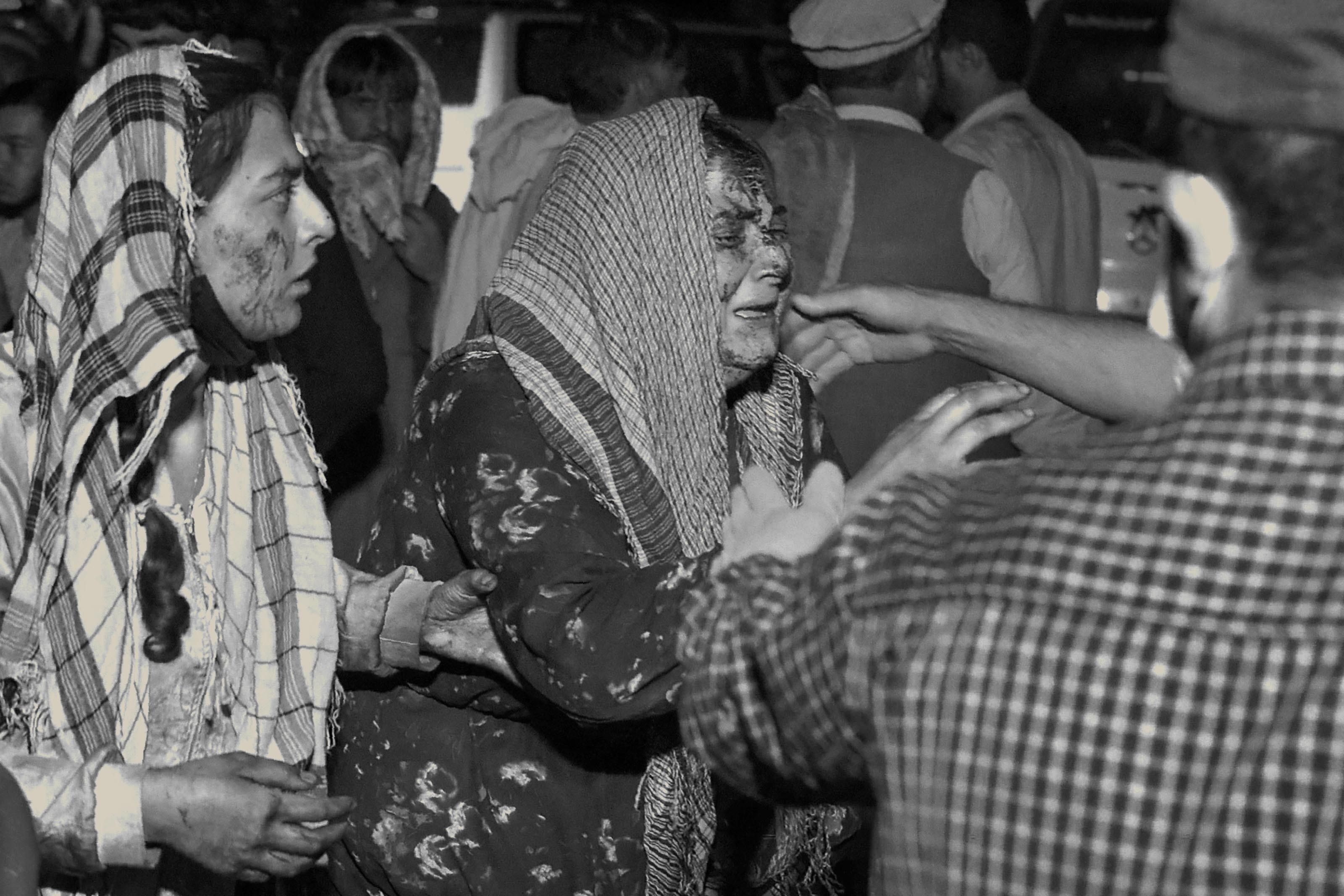 Wounded women arrive at a hospital for treatment after a deadly blast outside the airport in Kabul on Aug. 26.