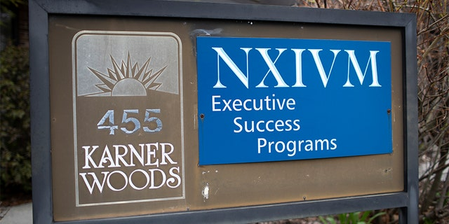 The NXIVM Executive Success Programs sign outside of the office at 455 New Karner Road on April 26, 2018 in Albany, New York. Keith Raniere, founder of NXIVM, was arrested by the FBI in Mexico in March of 2018.