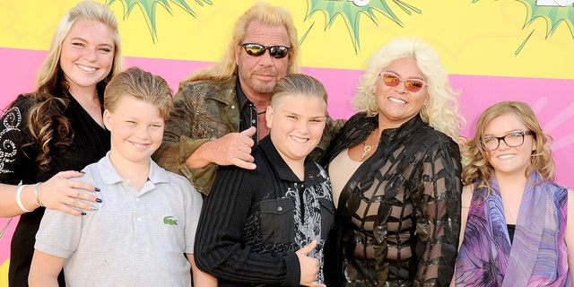 Cicily Chapman, left, and sister Bonnie, right, say their dad, Duane 'Dog' Chapman, center, didn't invite them to his wedding to his new wife. Their mother, Beth Chapman, second from right, died of throat cancer in 2019.