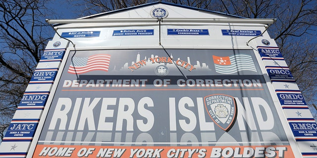 Signage is seen outside of Rikers Island, a prison facility, where multiple cases of the coronavirus disease (COVID-19) have been confirmed in Queens, New York City, U.S., March 22, 2020. (REUTERS/Andrew Kelly)