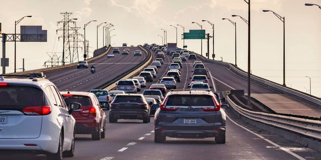 Vehicles head slowly east on the Interstate-10 twin spans leaving New Orleans while only a trickle of cars heads west back into the city before landfall of Hurricane Ida in New Orleans, Saturday, Aug. 28, 2021. (Associated Press)