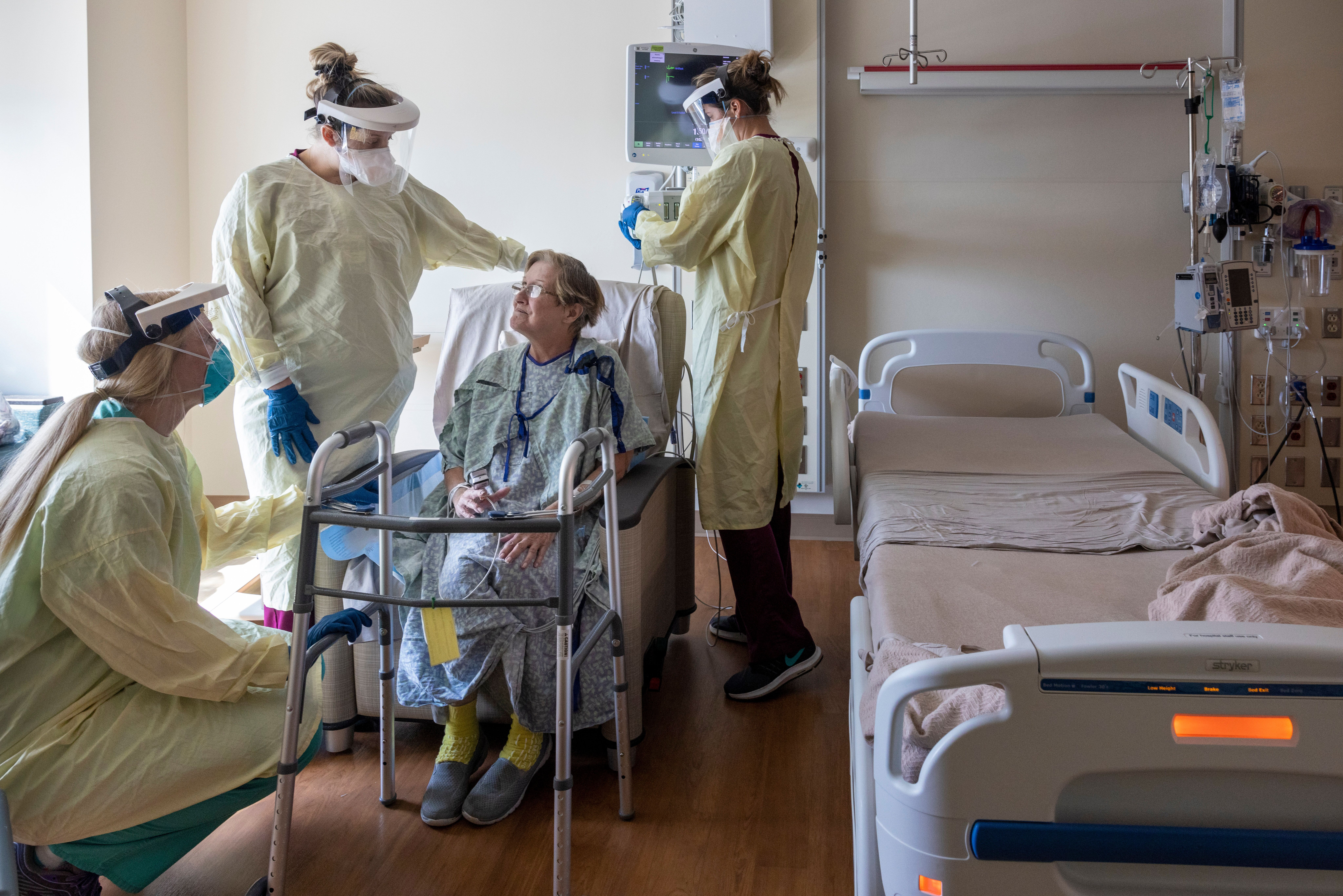 A COVID-19 patient is seen being treated at the Ochsner Medical Center in Jefferson, La. The state's hospitals, already packe
