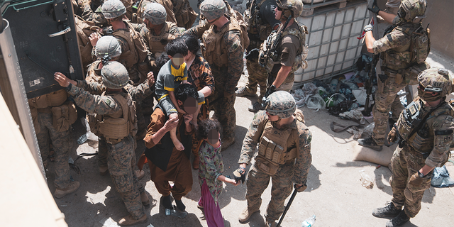 (August 20, 2021) U.S. Marines and Norweigian coalition forces assist with security at an Evacuation Control Checkpoint ensuring evacuees are processed safely during an evacuation at Hamid Karzai International Airport, Kabul, Afghanistan, Aug. 20. U.S. service members are assisting the Department of State with a non-combatant evacuation operation (NEO) in Afghanistan. (U.S. Marine Corps photo by Staff Sgt. Victor Mancilla)